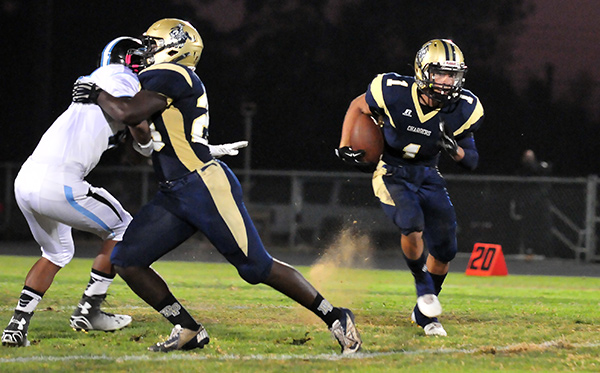 Angel Davison, running around a block from Manny Nwosu, led Dos Pueblos in rushing with 109 yards on 15 carries.