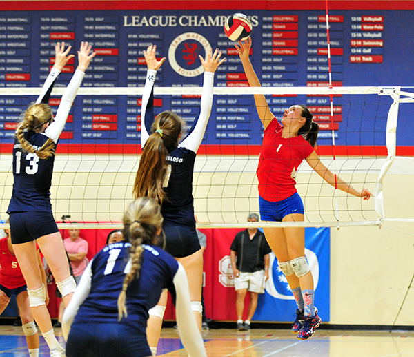 Anika Wilson of San Marcos tries hit past the Dos Pueblos block.