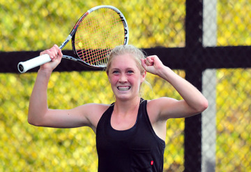 Caisey Lee Emery reacts to winning the singles championship.