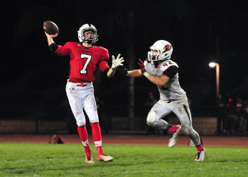 Carpinteria quarterback Jimmy Graves gets rid of a pass while being pressured by  Bishop Diego's Matt Shotwell.