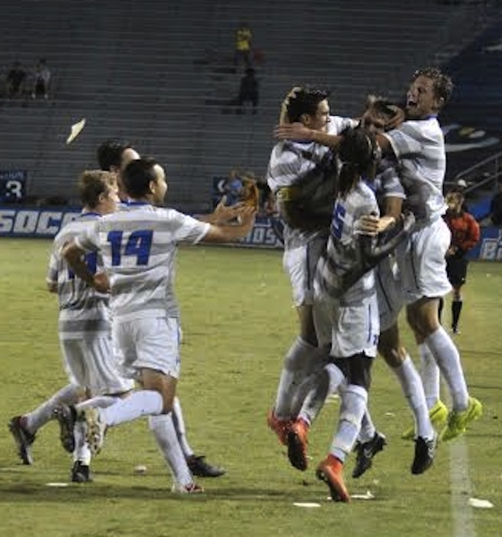Nick DePuy is mobbed by Gaucho teammates after scoring the game-winning goal with 30 seconds left in regulation time. (Felipe Garcia photo).