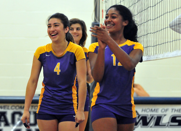 Karla Chavez, left, and Emily Beasley, right, gesture to their fans during the match.