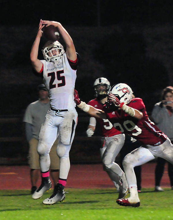 Bishop Diego's John Harris hauls in a touchdown pass from quarterback Spencer Stovesand in the third quarter.