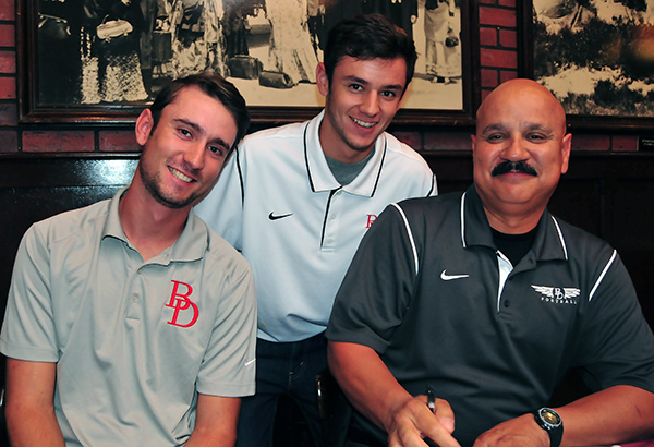 Longtime Bishop Diego assistant football coach Ralph Molina (right) was joined by his sons Gabe (left) and, Daniel at Monday's Santa Barbara Athletic Round Table press luncheon.