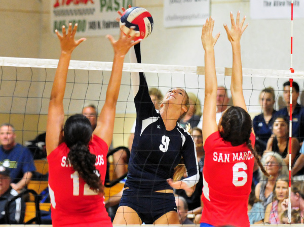 Natalie Klapp of Dos Pueblos tips over San Marcos blockers during the Chargers' five-set match victory at the Thunderhut. (Presidio Sports Photos)