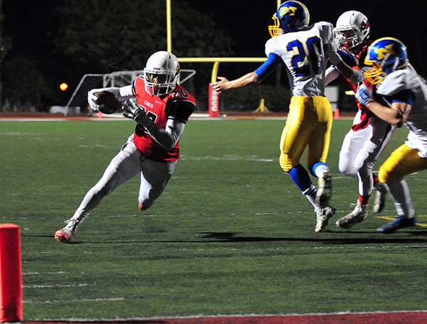 Bishop Diego's Abel Gonzalez breaks around the edge with the end zone in sight.
