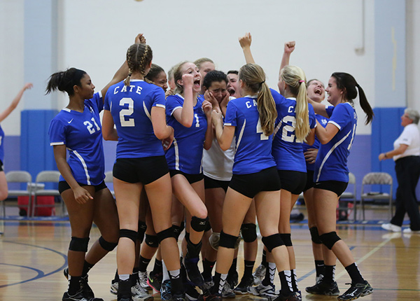 Cate's No. 1 girls volleyball team celebrates its victory over Carpinteria on Tuesday.
