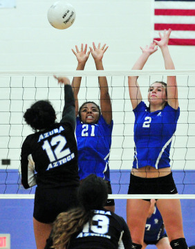 Cate's Xandrine Griffin and Delaney Mayfield get up in front of Azusa's Brianna Gomez.