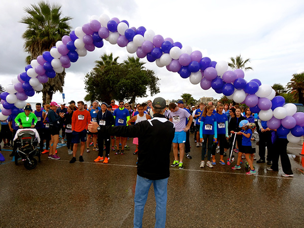 Competitors gather for the start of the Domestic Violence Solutions 5k Run for Love on Saturday at Goleta Beach Park. (Randy Weiss Photos)