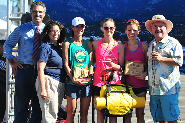 The women's winners were announced by Award Ceremony MCs John Palementari, left, and Drew Wakefield, right, and joined by Santa Barbara Mayor Helene Schneider. Athletes include Deanna Odell, left, Paige Burgin, middle, and Jen Marquardt, right.
