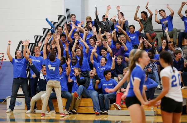 Cate's Blue Crew cheering section shows their support for the Rams volleyball team.