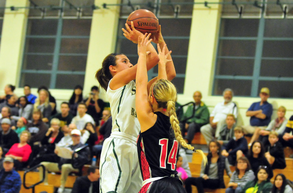 Santa Barbara High's Amber Melgoza shoots over Hanford's Shay Gibbons. (Presidio Sports Photo)