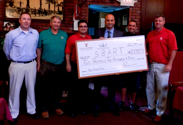 Rich Nahas, center, the general manager of Glen Annie Golf Course, presents a check for $2,250 to the local high school golf programs.