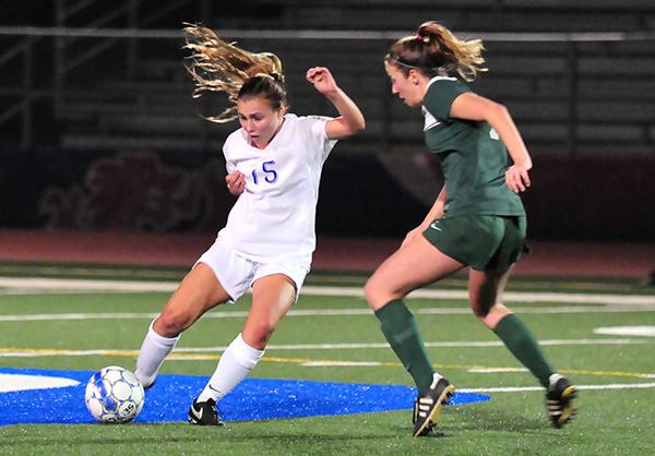 Chloe Hamer of San Marcos dribbles past a Santa Barbara defender during the Royals' 1-0 win.