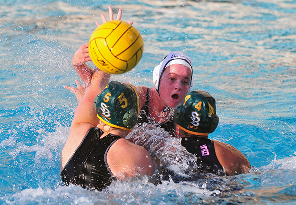 Santa Barbara's Grace Raisin and Jessie Brummett give Dos Pueblos' Ryann Nueshul plenty of defensive attention.
