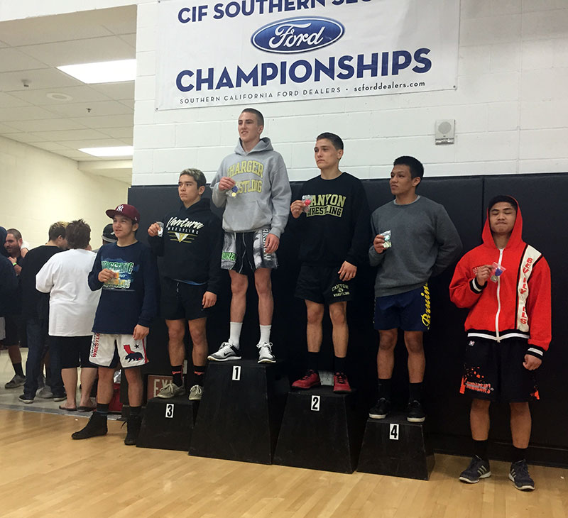 Cameron Cox stands on top of the podium for Dos Pueblos.