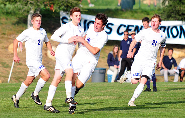 Cate's Ryan Borchardt is chased by teammates after scoring the game's first goal on Friday. (Presidio Sports Photos)