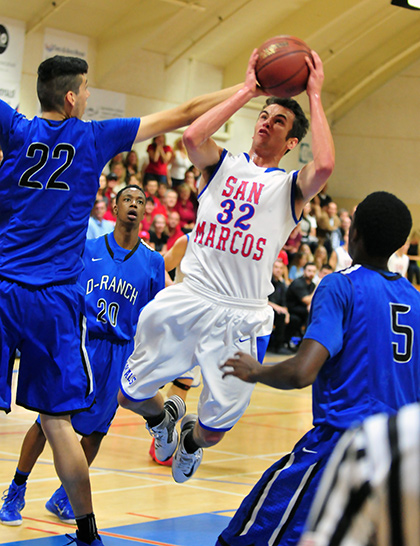 Scott Everman drives to the basket against Diamond Ranch's 7-foot center Roman Silva.