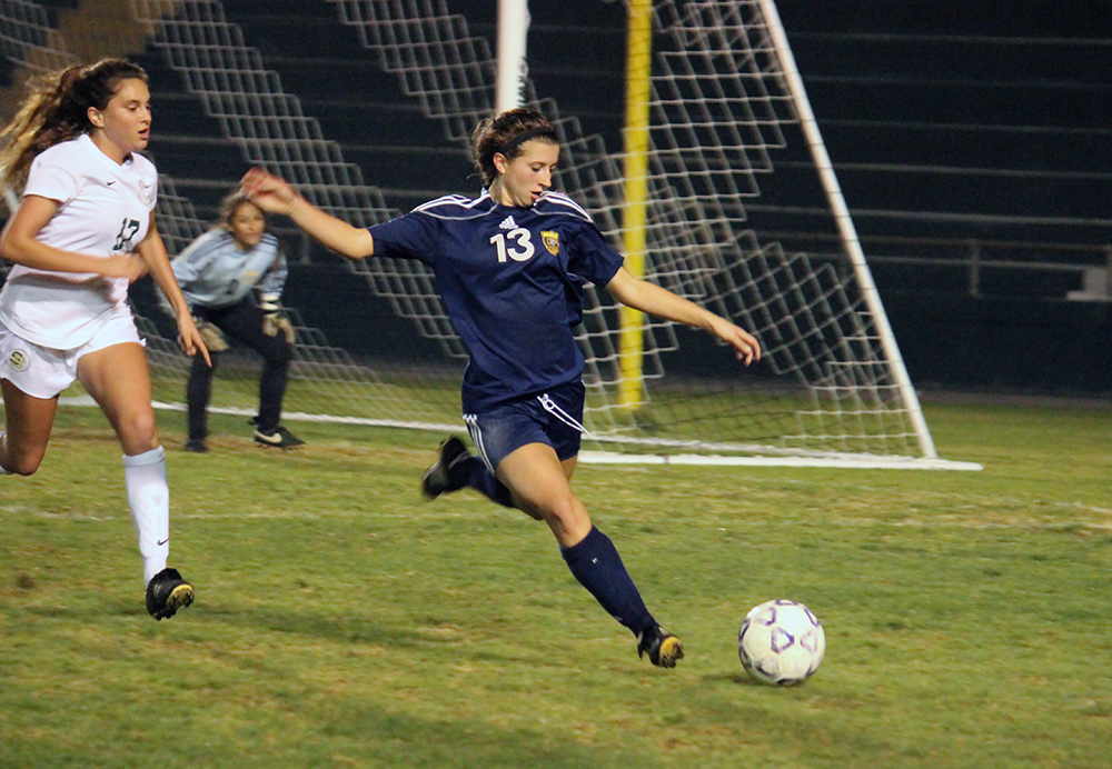 Dos Pueblos' Weslea Greyson takes the ball away from the DP goal. (Maddie Hoover / Presidio Sports)