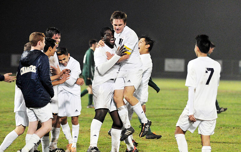 Drew Richard leaps into the arms of Manny Nwosu as the Chargers celebrate their victory on Tuesday. (Presidio Sports Photos)