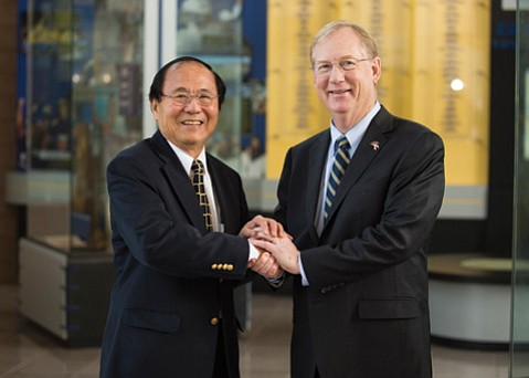 UCSB Chancellor Henry Yang with new Gauchos Athletic Director John McCutcheon. (Tony Mastres  Photo/UCSB Athletics)