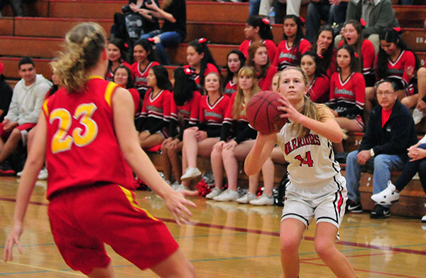 Carpinteria's Maddie Cleek gets set for a jump shot in front of Paraclete defender Michaela Reese.
