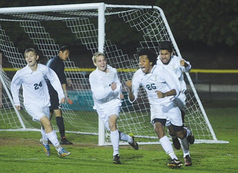 Santa Barbara's Ignacio Rendon celebrates his game-winning goal with teammates. (Randy Weiss Photo)