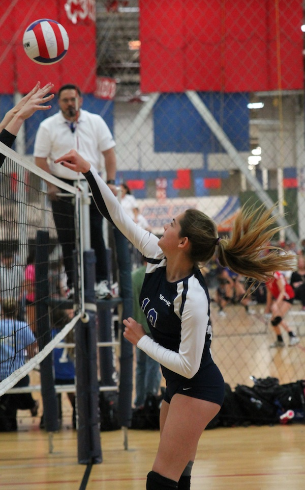 Sophie Breathed of the SBVC 15-Blue team swings past the block.