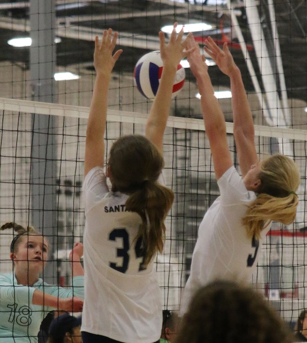 Chloe Mauceri and Ally Mintzer combine to block an attack for the SBVC 14-Blue