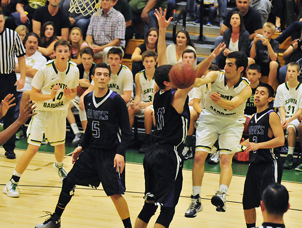 Max Henderson looks for the open teammate out of the double team on Wednesday.