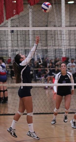 Allie Sundara of the Santa Barbara Volleyball Club's 18-Blue team sets the ball as teammate Natalie Klapp looks on.