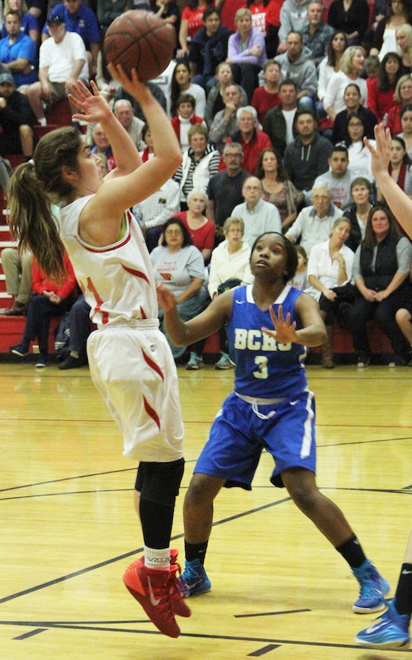 Bishop's Jordyn Lilly pulls up for a jumper against Bakersfield Christian's Kameron Taylor. Lilly scored a game-high 23 points.