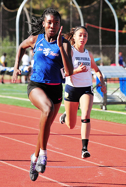 San Marcos freshman Jennifer Nnoli sprints to victory in the 100 meters.