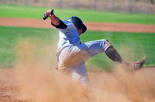 Santa Barbara Trevor Moropoulos slides across home plate for the Dons' third run. (Presidio Sports Photos)