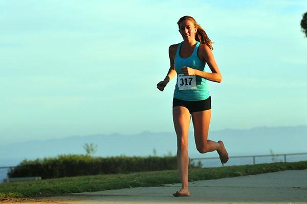 Kate Stuart runs barefoot through Shoreline Park.