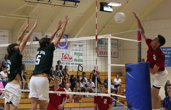 Connor Everman of San Marcos hits against the Santa Barbara block of Cord Pereira (5) and JM Cage. Everman led the Royals' attack with 23 kills.