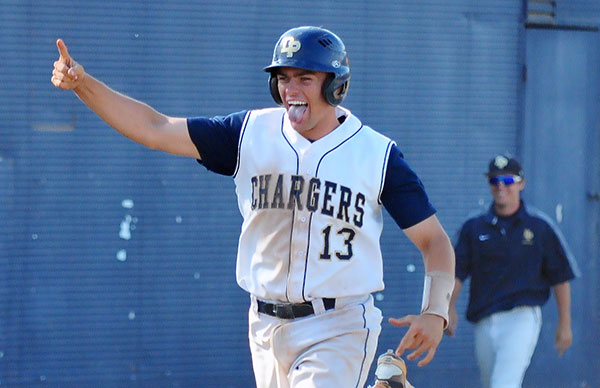 Dos Pueblos' Nick Noggle approaches home plate following his game-winning home run in the bottom of the seventh inning of a CIF Division 2 playoff game.