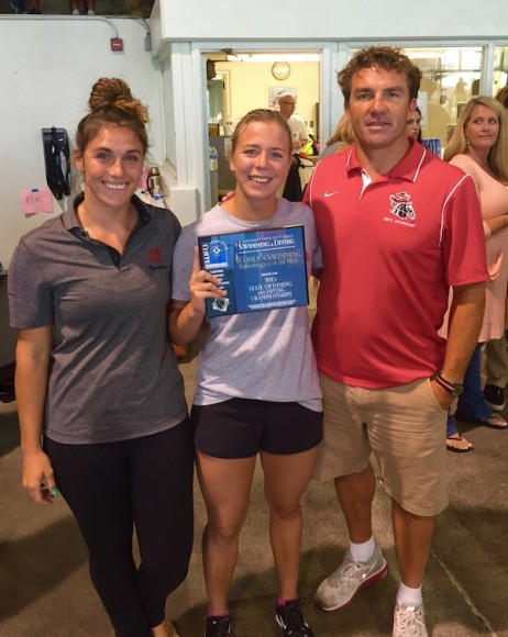 SBCC swimmer Rachelle Visser poses with coaches Sierra Peltcher and Chuckie Roth after receiving the Performance of the Meet Award at the state championships.