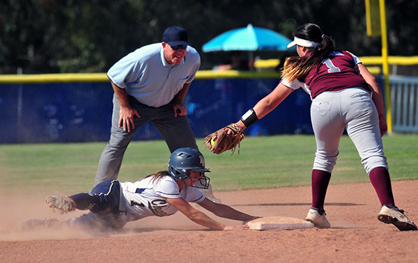 Dos Pueblos' Lauren Marmo beats the tag from Torrance shortstop Jade Arslanian for a stolen base.