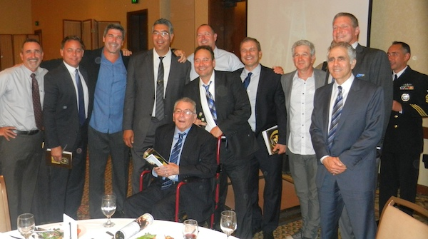 Former SBCC coach and Court of Champions inductee Frank Carbajal is surrounded by former players and assistant coaches. The group includes inductees Gerry Karczewski and Jim Eyen.