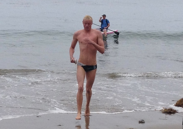 Alex Roderick emerges from the water as the champion of the Semana Nautica 6-Mile Ocean Swim.
