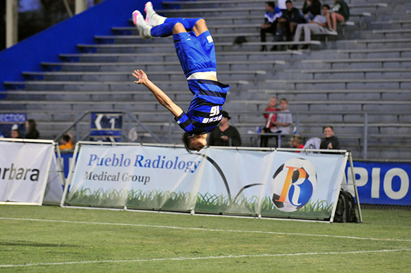 Kevin Feucht does a back flip after scoring UCSB's third goal.
