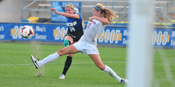 UCSB newcomer Mallory Hromatko takes a shot past Westmont defender Renee Gonsalves in Thursday's exhibition opener at Harder Stadium. (Presidio Sports Photo)