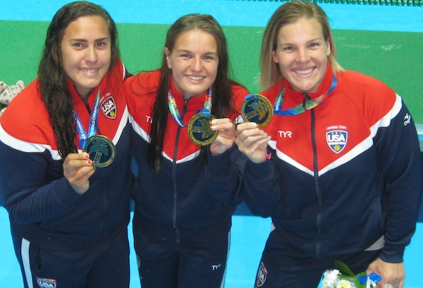 Sami HIll, left, Kiley Neushul and Kami Craig show off their gold medals from the FINA Women's Water Polo World Championships. The local trio won three golds this year, taking titles in the World League, Pan American Games and World Championships.