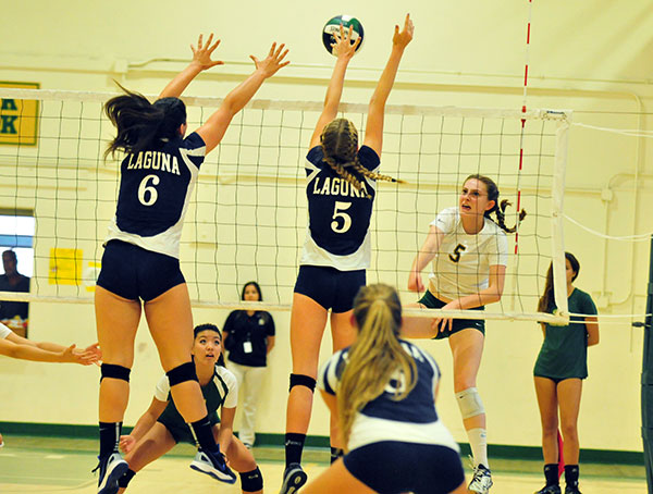 Lourda Weger hits just over Laguna Blanca's Dani Abrams, left, and Laurel Kujan, right. (John Dvorak/Presidio Sports)