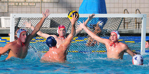 The San Marcos defense, Miles Cole on the left, goalie Jack Palmer in the middle, and Adam Fuller, right, defends a shot by Dos Pueblos' Taylor Gustason. (John Dvorak/Presidio Sports Photos)