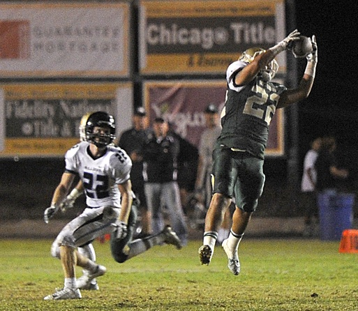 Santa Barbara linebacker Junior Garcia intercepts a pass intended for Buena's Mason Beling.