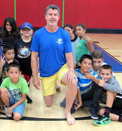 John Gavin is surrounded by kids at the Santa Barbara Boys & Girls Club. (Courtesy Photo)