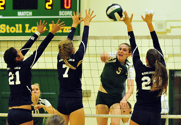 Santa Barbara's Lourda Weger copes with Dos Pueblos blockers Bianca di Patrizi, left, Danica Minnich, center, and Rebi Neely, right. (John Dvorak/Presidio Sports Photos)