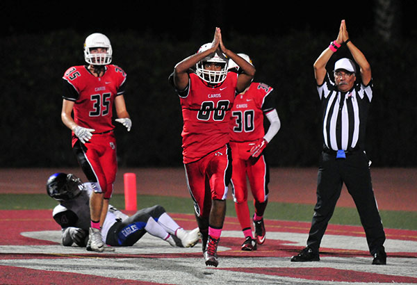 Cardinals sophomore Will Goodwin celebrates Bishop's safety in the third quarter.